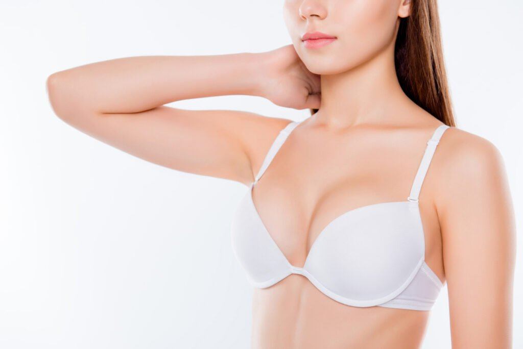 Woman With Breast Implants ask Board Certified Cosmetic Surgeon about breast implant rippling