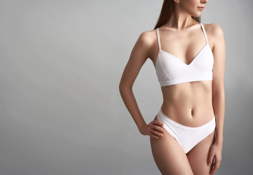 Woman Enjoys Results from Liposuction and Non Surgical Fat Reduction procedures from American Board of Cosmetic Surgery certified surgeons